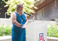 Diana Liverman speaking at podium in ENR2 building